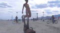 Clothed Male Naked Female Desert Gymnastics